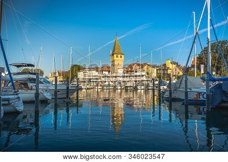 Lindau, Germany, July 2019 - View Of Marina And The Mangturm Tower Situated In The German Port Linda