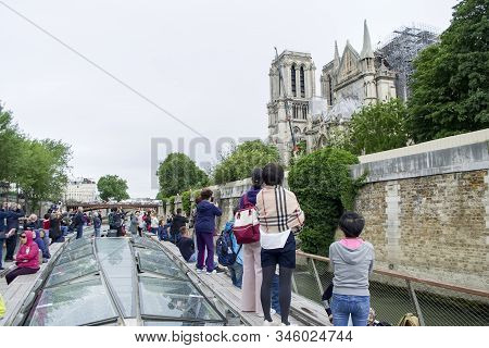 South Side Of The Notre Dame Cathedral In Paris Damaged By Fire. View Of The Cathedral From The Sein