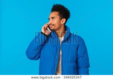 Tensed And Angry Young African American Man Bothered Someones Picking Phone Too Long, Smirk And Star