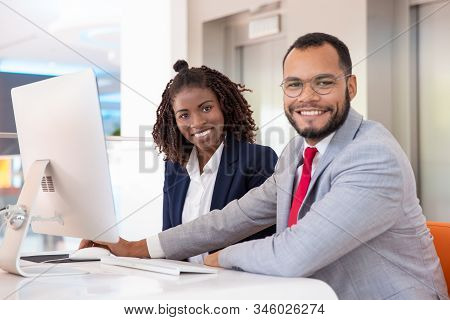Cheerful Business People Using Desktop Computer. Young African American Business People Working With