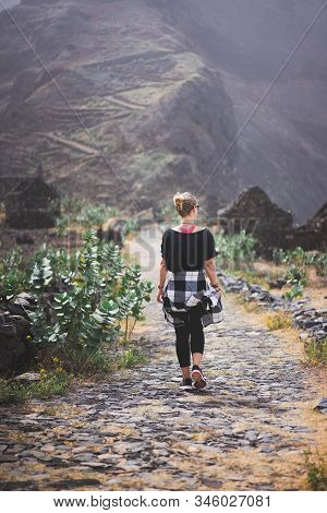 Woman Hiker On The Picturesque Coastal Cobbled Route. The Road Joins The Towns Of Cruzinha, Fontainh
