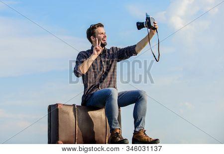 Travel Blog. Man Sit On Suitcase. Handsome Guy Traveler Retro Camera. Travel With Luggage. Travel Bl