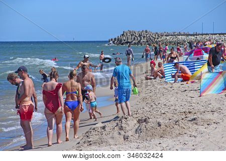 Wladyslawowo / Poland. 24 June 2019: People Relax On Beach Of Baltic Sea During Summer Vacation. Bal