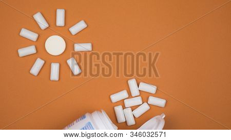 Chewing Gum On A Light Brown Background. Set Out In The Form Of The Sun