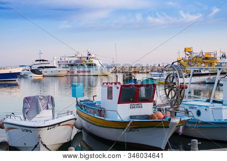 Agia Napa, Cyprus - October 22, 2019: Different Fishing Boats In The Harbour On Sunset. Touristic Ve