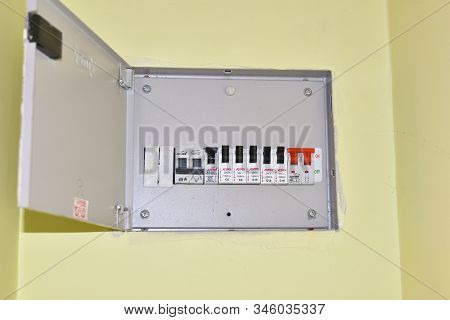 Jhargram, India- January 19, 2020: Voltage Switchboard With Circuit Breakers. A Finger Is About To S