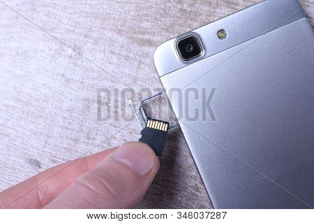 Flash Memory Data Storage Concept : A Tray With A Micro Sd Card On White Background. A Memory Card I