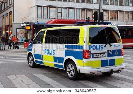 Stockholm, Sweden -   January 20, 2020: Rear And Side View Of A Swedish Volkswagen Make Police Van I