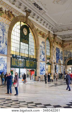 Porto, Portugal - Jan 10, 2020: Interior Of Sao Bento Railway Station With Typical Azulejo Tiles. Ty