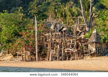 Ko Phayam, Thailand - February 18, 2019: Famous Hippie Bar made from driftwood on Ko Phayam island