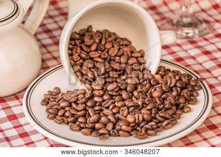 Roasted Coffee Beans In Cup And Plate On Coffeeshop Table. Fresh Gourmet Flavor Aroma. Delicious Fai