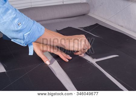Side View, Hands Of A Female Couturier At The Table, Measure The Borders Of Sewing On Fabric Using A