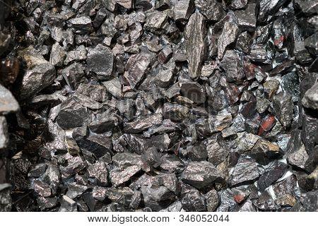 Close Up View Of The Iron Ore. Rough Hematite, Iron Kidney Ore Stone. Pieces Of Ferrotitanium Closeu