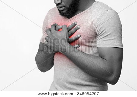 Cropped Of Afro Man Suffering From Acid Reflux Or Heartburn, Symptomatic Indigestion Or Gastritis Di