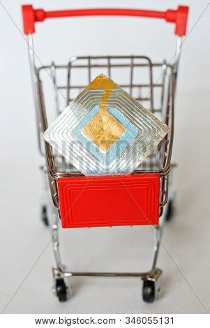 The Metal Trolley From The Supermarket, In Which Lies The Rfid Tag. Goods Security And Alarm. Vertic