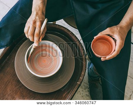 Ceramist At A Pottery Workshop Topv View Photo
