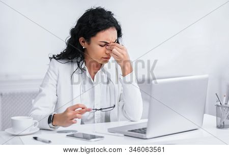 Eye Strain. Exhausted Hispanic Businesswoman Suffering From Computer Vision Syndrome. Free Space