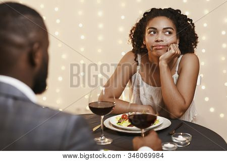 Afro Woman Feeling Bored At First Date At Restaurant, Couple Having Dinner, Drinking Wine