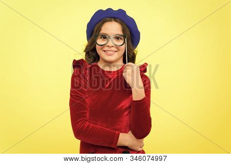 Accessory For Celebration. Happy Little Child Glasses Props. Funny Small Girl Holding Glasses Photo