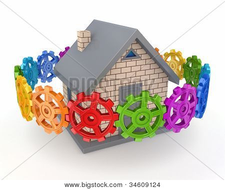 Colorful gears around small house.