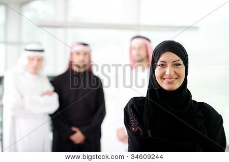 Arabic business woman working in team with her colleagues at office poster