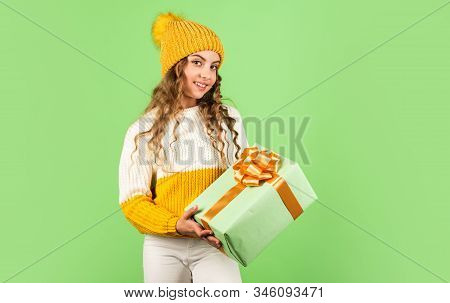 Christmas Is The Time To Please. Joyful Little Girl Knitted Hat And Sweater. Kid Hold Present Box Gr
