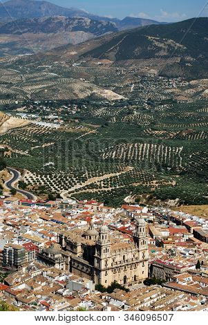 View Across The City Rooftops With The Cathedral In The Centre And Olive Groves To The Rear, Jaen, J