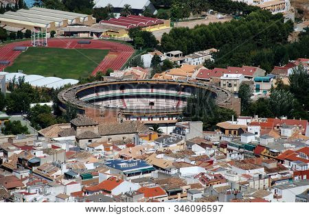 View Over The City Rooftops And Bullring, Jaen, Jaen Province, Andalucia, Spain, Western Europe.
