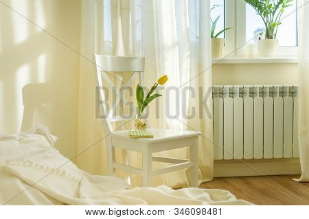 Light Spring Bedroom Interior, Bed, White Chair, Glass With Yellow Tulip, Window Light Curtains, Pas