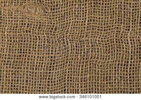 Rustic Jute Sackcloth As Texture Background. Brown Burlap. Closeup Rough Natural Burlap Fabric Textu