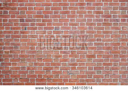 The Old Masonry Of The Brick Wall Is Well Preserved. The Texture Of The Old Brick Is Predominantly R