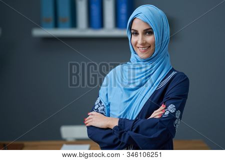 Muslim female student learning at home