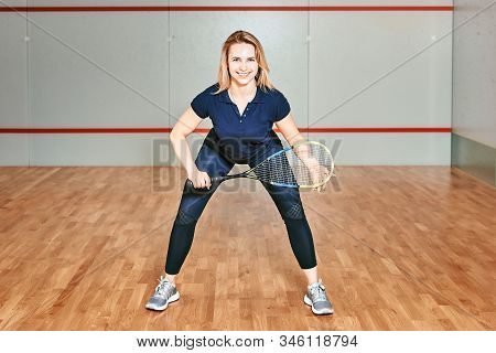 Portrait Of A Sporty Blonde Woman. Young Athletic Girl Holding Squash Tennis Racquet