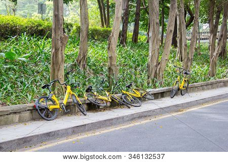 Shenzhen, China - November 14, 2018: Yellow Bicycles Of A Bicycle Sharing Company Are Carelessly Lai