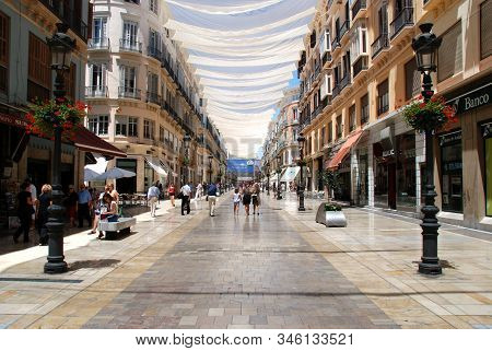Malaga, Spain - July 11, 2008 - Shops And Shoppers Along The Calle Marques De Larios Main Shopping S