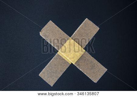 Adhesive Bandage Against A Black Background. Medical Adhesive Bandage Stock Image. Image Of Medical