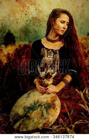 Beautiful Shamanic Girl Playing On Shaman Frame Drum In The Nature, Old Effect.