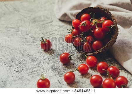 Tiny Cherry Tomatoes (ciliegini, Pachino, Cocktail). Group Of Cherry Tomatoes On A Gray Concrete Bac