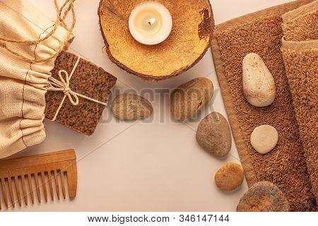 Spa And Wellness Concept, Natural Coffee Scrub Soap, Oil Cosmetics Spray, Peeling Sand Stone,towel,n