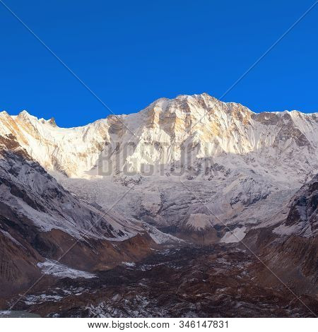 Morning View Of Mount Annapurna From Annapurna South Base Camp, Panorama With Blue Sky, Circuit Trek