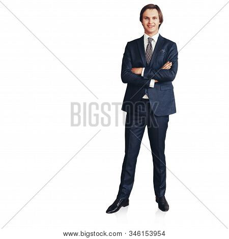 Successful Young Entrepreneur Standing In His Office. Isolated On A White Background