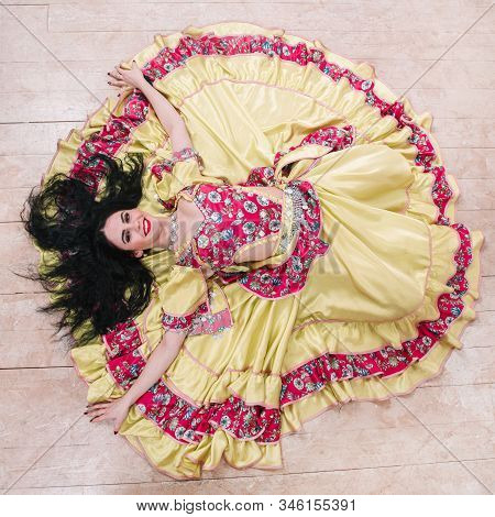 Top View. Smiling Young Woman Performing Passionate Gypsy Dance.