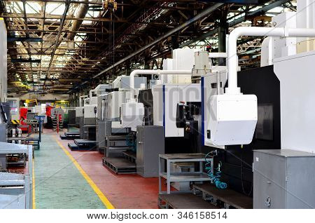 Workshop Of A Factory With Automatic Cnc Turning Machines. High Precision Computerized Cnc Plasma Cu