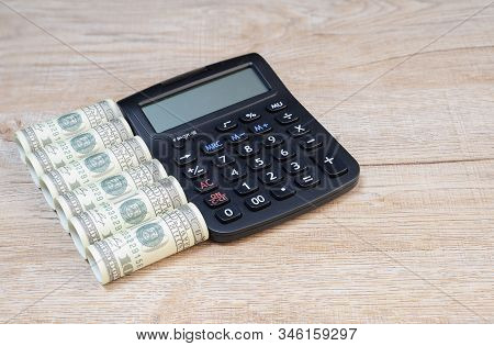 A Top View Calculator With A Dollar And Wallet On The Wooden Table Background