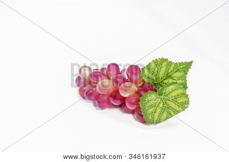 Red Grapes Invented On A White Background