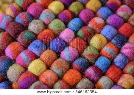 Knit Yarn On A Colorful Background, Laid Together.