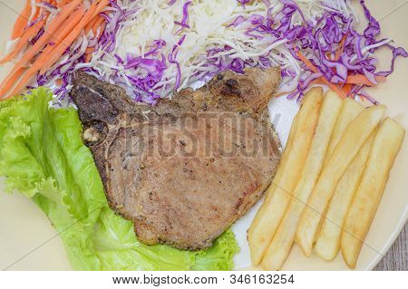 Grilled Steak With French Fries And Green Salad
