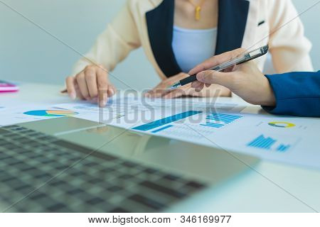 Business People Discussion And Summary Financial Information At Meeting. Concept Business And Financ