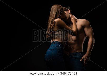 Sexy Young Couple Kissing Isolated On Black