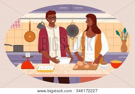 Man And Woman Cooking Dishes At Home. Couple Preparing Food In Kitchen. Interior Of Room With Kitche